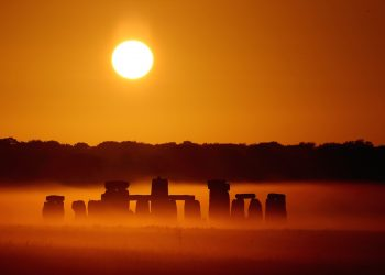 SWNS Pictures of the Year 2015 - One hundred of the most compelling images on the SWNS wire this year as chosen by our picture editors.The sun rises over Salisbury Plain as it's light illuminates the mist shrouding Stonehenge, Wiltshire, July 7 2015. Amateur photographer Robin Morrison made half a dozen visits to the ancient megalith, travelling over a hundred miles each time, to capture the precise lighting conditions he wanted. The normal weather patterns in the UK mean that a clear sky just a few minutes after sunrise is uncommon - a clear sky at sunrise combined with a misty morning is an extremely rare occurrence.