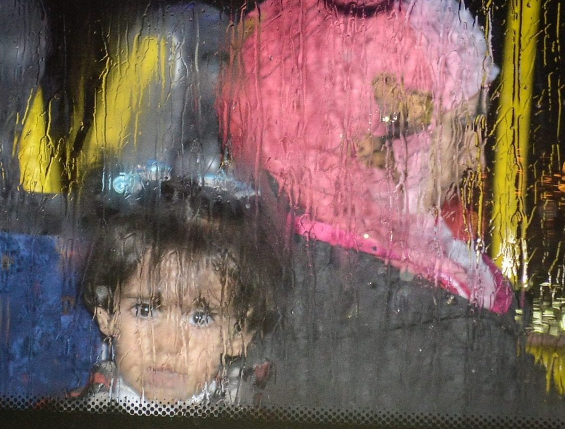 SWNS Pictures of the Year 2015 - One hundred of the most compelling images on the SWNS wire this year as chosen by our picture editors. Refugees from Syria leave Glasgow Airport in five coaches in heavy rain, November 17, 2015, from where they will be dispersed to their new homes within Scotland. See SWNS story SWREFUGEE: The first charter flight carrying Syrian refugees arrived in the UK yesterday (Tues) as part of the Government's resettlement scheme. Around 100 people were transported by plane from refugee camps in the Middle East, travelling from Beirut in Lebanon to Glasgow Airport. Many have been described as vulnerable and some had stayed in camps for up to four years. Landing in Glasgow at 3.30pm yesterday afternoon, the first arrivals were expected to be resettled by local authorities across the country, including Glasgow and Edinburgh.
