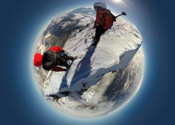 SWNS Pictures of the Year 2015 - One hundred of the most compelling images on the SWNS wire this year as chosen by our picture editors.   Pictured - Stephan Siegrist (L) and David Fassel (R). See South West copy SWHIGH. A pair of climbers retraced the steps of the brave Brit who first conquered the deadly Matterhorn 150 years ago to pose for a unique 360 degree pic à from the top of the WORLD. The high-altitude ÃbirdÃs eye viewà picture looks down on hardy Stephan Siegrist and David Fassel as they stood on top of the dangerous Swiss mountain à with the entire world in the background. The remarkable image was taken with a Google StreetView-style camera mounted on a Ãselfie stickà à creating the illusion that the pair were stood thousands of miles above the Earth.  Mammut / Ross Parry