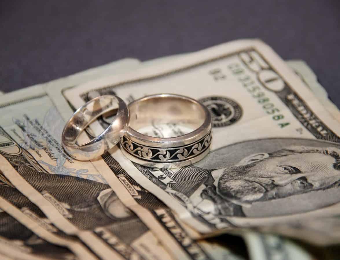 Weddings rings and large bills of money