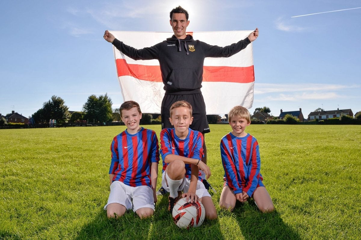 """PE teacher Sam Chambers, 24 from Weeden Bec Primary School near Northampton pictured with three of his players (from left: Will, Joe and Ewan. See Masons copy MNFOOTBALL: An unbeaten under-12s primary school football coach has applied for the England job and says he'd take it """"depending on how much money they offered"""".  If he got to the big spot, the ambitious football coach said his first port of call would be to """"take the boys out for a cheeky Nando's-anyone who cannot deal with Extra Hot is not playing for me"""". Although it was a shame to lose Sam Allardyce, Sam Chambers said it just proved that the FA had appointed the wrong Sam first time around and is convinced he's the man for the top job. Ladbrokes gave him 1,000-1 odds of getting the top job after his first application for the job following the stepping down of Roy Hodgson."""
