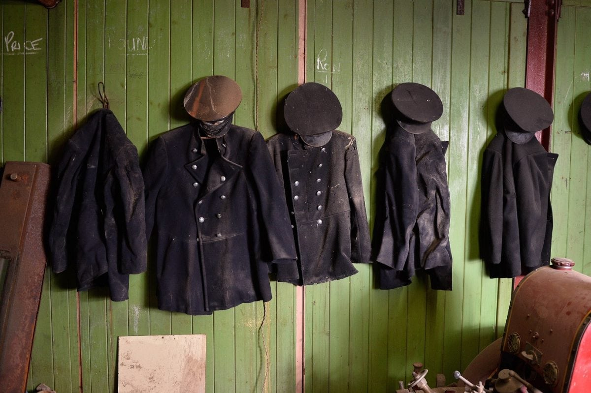 """Old uniforms are still hanging on the walls.  These remarkable pictures show a fire station which was left untouched for more than 60 years before it was discovered in the cellar of an old Co Op factory.  See NTI story NTIFIRE.  The secret fire station is complete with 1920s firefighting equipment, pumps, uniforms and coiled hoses.  A half-drunk bottle of lemonade and exercise programmes were also found in the cellar of the former Co Op factory in Dudley, West Mids.  Staff at shopfitting company The Allan Nuttall Partnership, which is now based in the building, heard rumours of a hidden fire station but dismissed it as an """"urban myth"""".  But when marketing manager Anna Bramford dug out some keys she was astonished to find fire regalia and pumps dating back to the 1920s."""