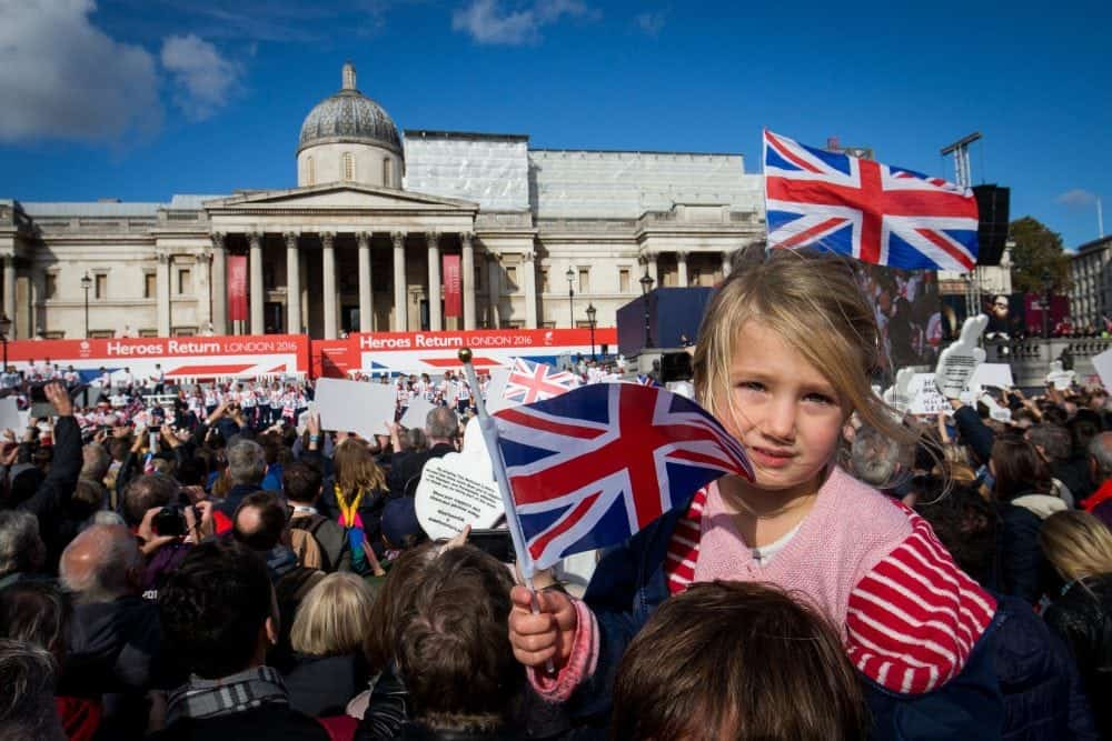 Rosie Chamberlain, 3, waves a flag as thousands of people pack into Trafalgar square for the London Heroes return event for the Great Britain Olympic team, London. 18 October 2016.