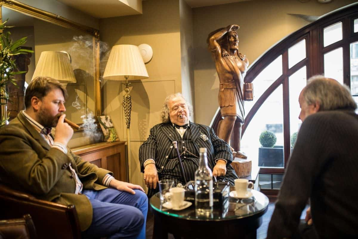 People smoke inside James J. Fox cigar merchant in London. See National New story NNCIGAR; Cigar lovers celebrate the birth of Winston Churchill in one of the only indoors smoking rooms at London's oldest cigar merchant.