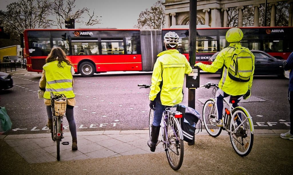 Cyclists in London staying safe by wearing high-visibility jackets. (Taken using my mobile phone.)