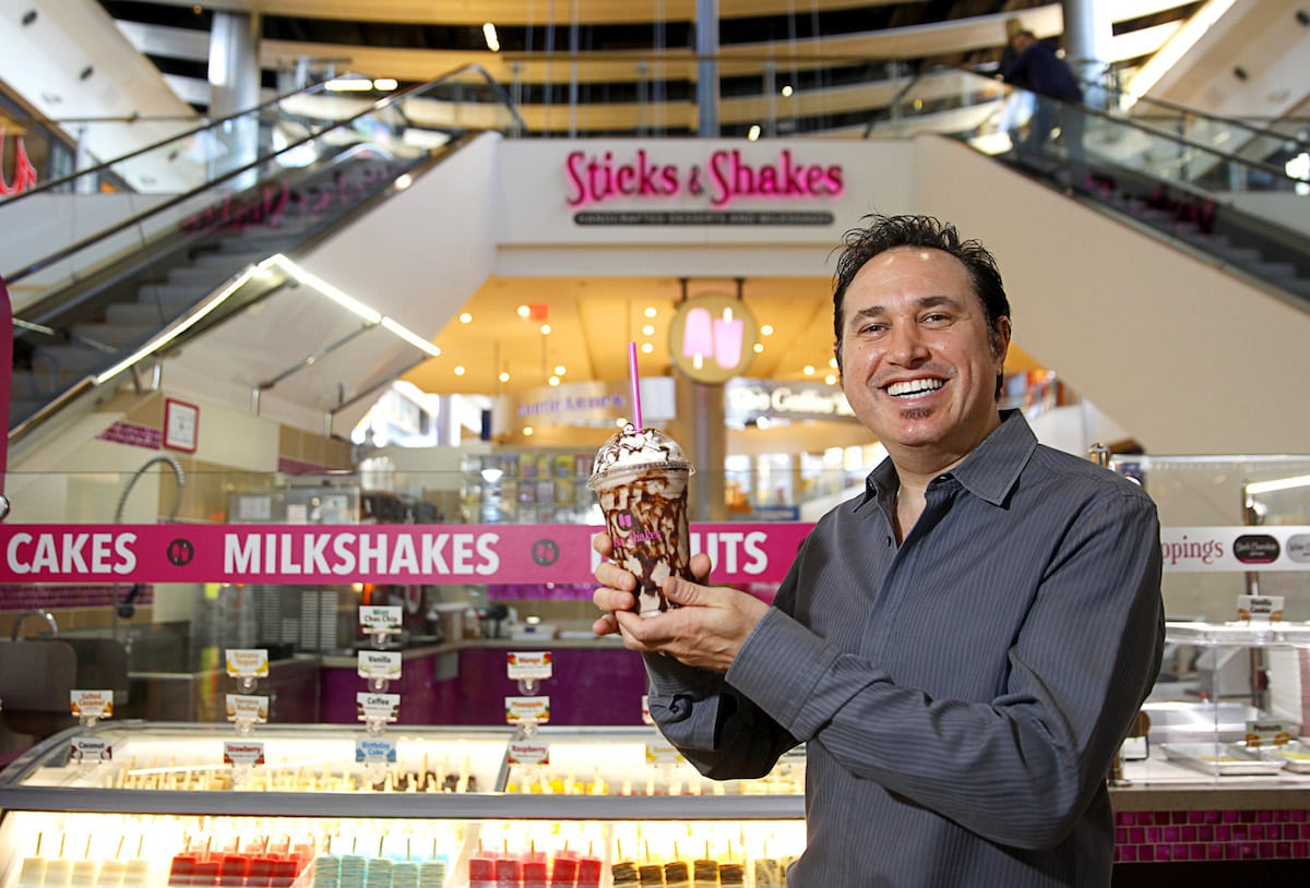"""Owner Mark Glassman poses with a """"Cookie Overload"""" milkshake at Sticks & Shakes in the Fashion Show Mall Tuesday, Jan. 13, 2015. The kiosk sells frozen gelato and sorbet on a stick as well as customized milkshakes. The company also has a location at the Galleria Mall in Henderson."""