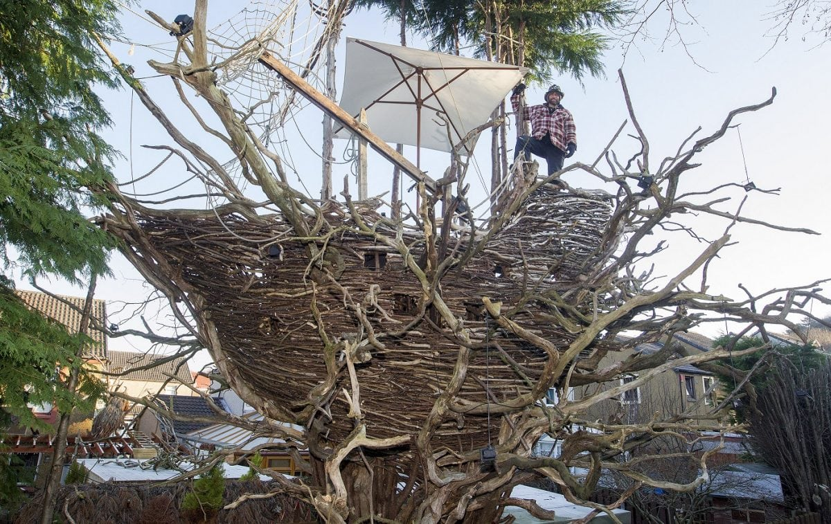 Fife-based sculptor and artist Denis Carbonaro with his Bark Park, larger-than-life creations including a woolly mammoth in the front garden, a huge spider crawling up the house, or a galleon ship in the garden made from foraged tree bark and foliage. Jan 26 2017 . See Centre Press story CPSHIP; A wacky sculptor has turned his property into a tourist attraction after creating an impressive galleon ship, nestled in trees at the back of his garden. Denis Carbonaro, 48, quit his job three years ago to return to his love of art, and soon turned to working as a sculptor. And now he hopes his popular garden in Dalgety Bay, Fife, can lay the future for a dedicated sculpture park. Denis, a former web designer originally from the Italian island of Sicily, has become famous in the area for his wooden sculptures of a mammoth and a spider. He uses only recycled wood in his art, often in the form of fallen branches which he finds in the area.