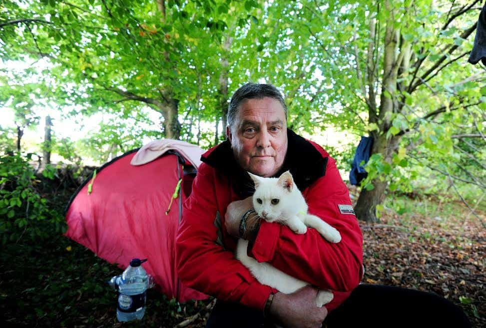 Brian Simmonds, 56 with Lilly the cat. See National copy NNTRAMP: An ungrateful beggar has turned his nose up at a kind woman who went out of her way to raise £1,300 to help find him a home - because he won't abandon his cat. Brian Simmonds, 56, sparked an outpouring of generosity after he was spotted living in a makeshift camp in woodland by the side of a main road with his feline friend Lily. Young mum Chloe-May Mouland launched a desperate bid to rehome the former electrician before Christmas - raising more than £1300 on an online crowdfunding site.