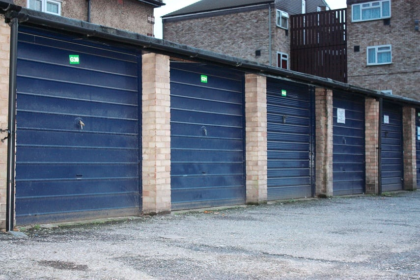 The garage doors in Midsummer Avenue, Hounslow. See SWNS story SWGARAGES3; Councils in London could build more than 16,000 homes by using space taken up by the unused or rundown garages it owns, according to new research. A study of local authority-owned lock-ups revealed 24 councils own 53,640 garages in the capital - with 41 per cent empty or in disrepair. Demolishing the garages and replacing them with affordable one-bedroom flats could go someway to solving the London housing crisis, where the average home now costs £475,000.  The figures were revealed in a Freedom of Information request by property crowdfunding platform Property Partner. Researchers at property firm calculated the total square footage of 22,000 council-owned empty garages in London was more than eight million. If these garages were replaced with developments made up of 500 sq/ft flats, it is estimated 16,000 affordable homes could be built. The London Assembly says the capital needs between 49,000 and 80,000 homes per year to cope with the projected population growth of a million in the next ten years.