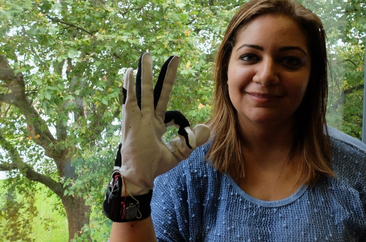 """Hadeel Ayoub wearing the smart glove which translates sign language - into speech. See National copy NNGLOVE: A savvy student has designed a 'smart glove' which translates sign language - into speech. PhD student Hadeel Ayoub designed the BrightSign to help people with speech disabilities communicate without needing an interpreter. Hadeel, who specialises in digital and software design at Goldsmiths University, has been working on the BrightSign for the past two years as part of her PhD project. She said: """"What it does is it translates sign language to text into speech in real time to allow people with speech disabilities to communicate with the general public without having to have an interpreter or someone to communicate on their behalf."""