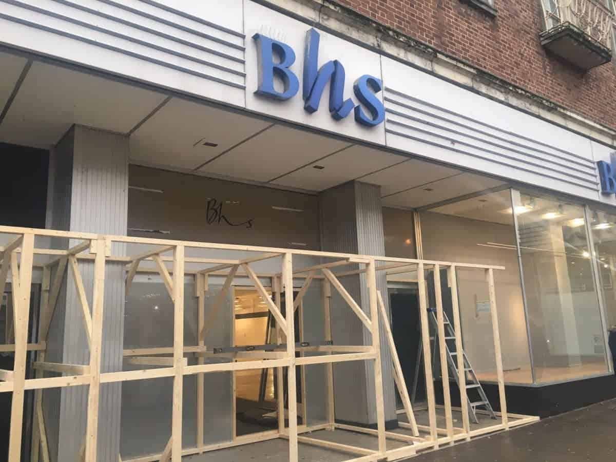 The wooden barrier at BHS on South Street, Exeter, Devon. See SWNS story SWBHS; The wooden barrier - around 10 ft tall - was being constructed today in the entrance of BHS on South Street. Workers say it is to stop rough sleepers from gathering in the doorways. The store has been vacant since the collapse of Sir Philip Green's former chain in August last year. In recent months its entrances had become a shelter to some of Exeter's homeless - including Justin Wilson, 41, and Tia Bamford, 30, who set up a camp beneath the store's southern doorway.