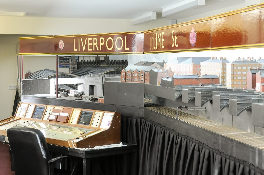 """John Holden has built a giant model of Liverpool Lime Street train station. See Ross Parry story RPYTRAIN; A rail enthusiast who fell in love with a train station as a child has now recreated it in full - in his BUNGALOW. Trainspotter John Holden, 69, has built a 45ft replica of Liverpool's Lime Street Station in his house. John has fond memories of trips to Liverpool as a youngster and first had the idea for the model while still a schoolboy. But it took almost 30 years for his dream to come to fruition. John has been crafting the stunning scale model for decades and it even includes station announcements, model trains, working signals and moving taxis and buses. His space-consuming hobby fills the entire extension of the detached bungalow in the East coast seaside town of St Annes, near Blackpool., he shares with wife, Pauline. The model, which shows the station in the 1940s, even boasts a sound system providing ambient background noise, train hooters and whistles and it also includes surrounding streets and nearby buildings, along with tiny figures of railway workers and passers-by. The couple's current home was specifically chosen because there was space to accommodate the model. John said: """"It has just grown and grown."""""""