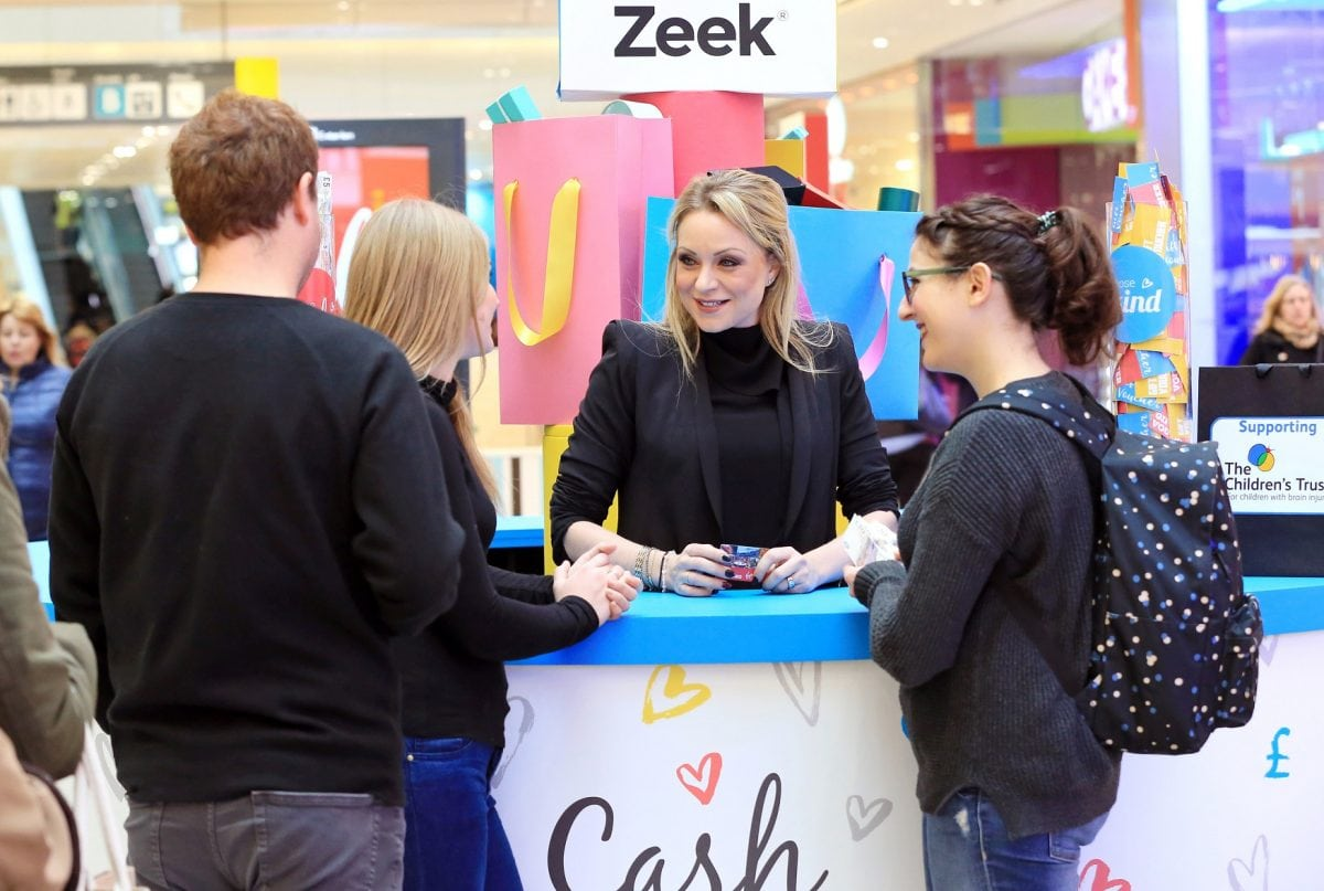 Rita Simmons, appeared at the Zeek Cash or Kind swap shop in Westfield, Stratford today helping shoppers swap unwanted gift cards for cash or donate the value to The Childrens Trust.Eastenders' Rita Simons swaps Albert Square for Westfield to launch swap-shop for unwanted gift cards.•Zeek's 'Cash or Kind' store at Westfield Stratford allows members of the public to swap unwanted gift cards for cash to keep or donate the value to charity •47% of Brits admit they have received an unwanted gift card or voucher, with  £300million wasted every yearToday, former Eastenders star Rita Simons swapped her market stall in Albert Square to launch a pop-up shop in Westfield, Stratford. The shop allows members of the public to exchange their unwanted gift cards for cash or donate the value to The Children's Trust, a leading charity for children suffering from brain injury.The swap-shop, open for one day only, was set up by Europe's biggest gift card marketplace, Zeek, in response to new research showing that 47% of Brits have at one time received an unwanted gift card or voucher, with an estimated £300million of unused credit in the UK every year.The vast majority of unwanted items will be re-sold (23%) or re-gifted (33%), however one in seven (14%) will never see the light of day, gathering dust in drawers or even being relegated to the bin.The gift card swap shop comes at the perfect time of year as, contrary to widespread belief, the most popular week for returning unwanted items is the second week of January, with 15% choosing to wait until the festivities have died down before hitting the high street. A sizeable 70% of us even went as far as to say they actively avoid the shops between Boxing Day and the New Year with half of us citing crowds as a reason to avoid the high street.Rita Simons, who exited the popular BBC soap in an explosive storyline over New Year, opened the shop, as eager shoppers got ready to exchange their unwanted gift