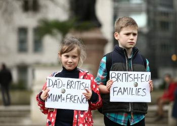 Louis, 10, and Margaux, 7, join pro migrant campaigners march to Westminster on #1daywithoutus a day of action where migrant workers are not going to work to show their contribution to society, February 20 2017. Hate and blame has been increasingly directed at migrants from many sections of politics and the general public.