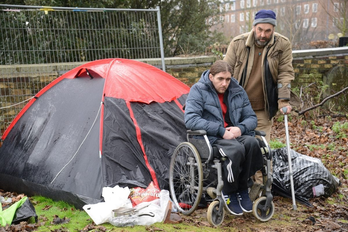 """Homeless Jonathan Martin and Chris Stanford who are living in a tent in Chatham. See National News story NNTRAMP; A pair of homeless men have set up camp in a graveyard to escape the abuse they receive on the streets - which they describe as """"the jungle"""". Chris Stanford and Jonathon Martin said they have had things thrown at them, been spat at - and mean-spirited locals have even tried to wee on them. Each day Chris, who uses crutches, helps Jon, who is paraplegic, into his wheelchair and the pair head to the high street in Chatham, Kent, to beg for change. Jon, 38, said he needs a wound on his foot dressed says the district nursing team refuses to visit him because he has no fixed address. *** Local Caption *** Homeless Jonathan Martin and Chris Stanford who are living in a tent in Chatham. See National News story NNTRAMP; A pair of homeless men have set up camp in a graveyard to escape the abuse they receive on the streets - which they describe as """"the jungle"""". Chris Stanford and Jonathon Martin said they have had things thrown at them, been spat at - and mean-spirited locals have even tried to wee on them. Each day Chris, who uses crutches, helps Jon, who is paraplegic, into his wheelchair and the pair head to the high street in Chatham, Kent, to beg for change. Jon, 38, said he needs a wound on his foot dressed says the district nursing team refuses to visit him because he has no fixed address."""