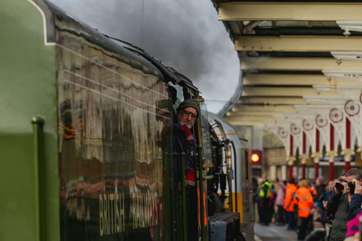 The Tornado steam engine comes into the station, pushed by diesel rolling stock, at Skipton station, West Yorks. The nine year old, scale replica locomotive doesn't have enough fuel to make the return journey, so only travels under full steam power when going north. February 14, 2017.