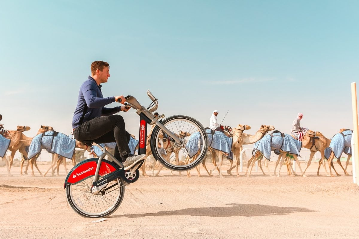 Chris Astil-Smith, 24 (L) with his The Boris bike in Dubai. See National copy NNBIKE: A biking mad entrepreneur made a round the world cycling trip - on a Boris bike. Chris Astil-Smith, 24, rented the Boris bike and cycled around seven cities including New Delhi, Las Vegas and Paris. For three weeks in January Chris cycled around five countries and spent two days in each city capturing the trip with friend and videographer Alex Tyrwhitt. He faced security trouble in New York as well as Delhi where the entrepreneur was forced to bribe security £10 at the Taj Mahal to cycle inside.