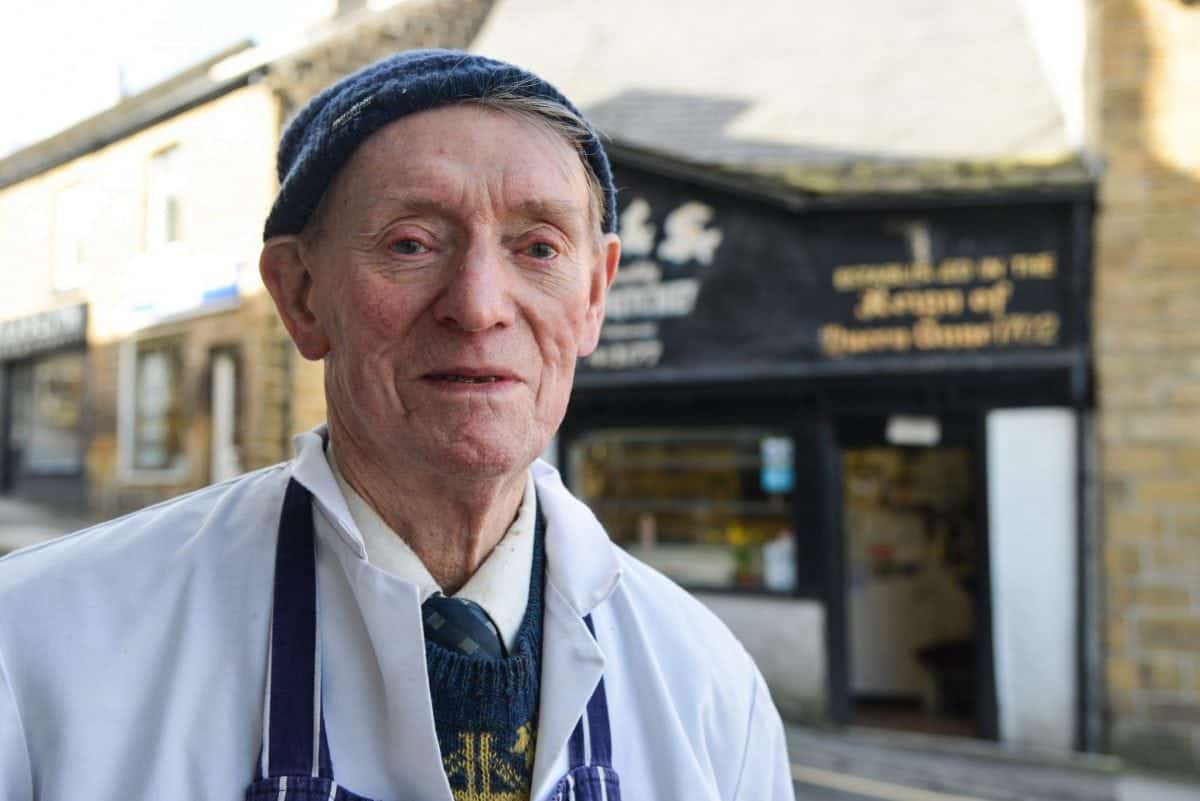 Frank Fisher, 87, is one of the oldest butchers in the country, but is uncertain of his shops future, pictured there near Sheffield, South Yorks., March 21 2017. See Ross Parry story RPYOLD: Britains oldest butcher who is the fourth generation to run the family business fears his dynasty is facing the chop - as he has no heirs to take over his lifes work. Dedicated Frank Fisher, 87, still works full time six days a week to keep the shop going. And although he is not yet ready to pin up his apron, he fears that once when he retires the business will go with him. The bachelor is the fourth of his generation to run the butchers, Fisher and Son Family Butcher's.