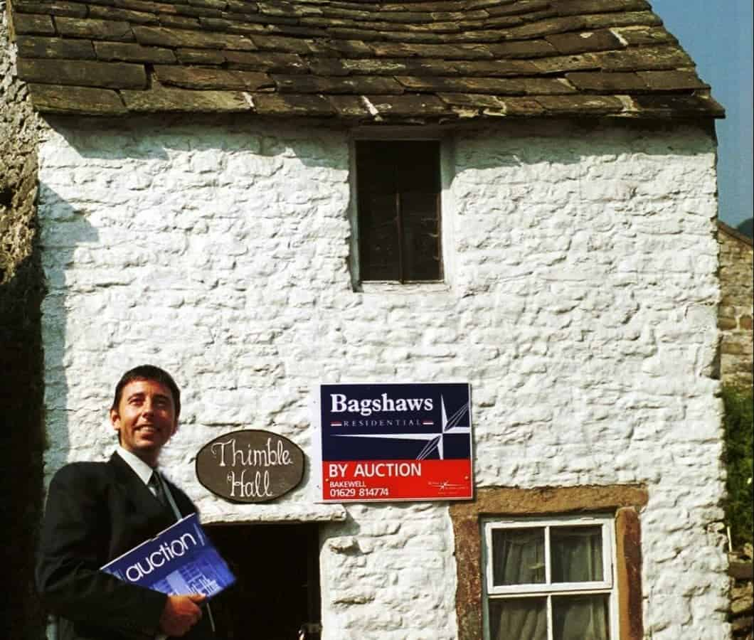 Mark Bramell from estate agents Bagshaws.  Derbyshire is home to a property once listed as the smallest detached house in Britain - Thimble Hall in Youlgreave.  See NTI story NTITHIMBLE.  It dates back to 1756 and measures just 11ft 10in x 10 ft 3in and stands 12 ft 2in high. Stretch out your arms and you practically touch either side of the rooms.  In August 2000, the Guinness Book of Records proclaimed it the smallest detached property in Great Britain. And yet 100 years ago, a family of eight lived there.  Such is its quirkiness, when it went up for auction in 1999 it sparked bids from all over the world including Hong Kong, Athens and New York. It's claimed there was even an offer from Uri Geller.