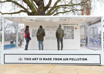 EDITORIAL USE ONLY Visitors look at artworks inside the Tiger Beer 'Clean Air Gallery' in Brixton, the works were created using Air-Ink™, the first ink to be made from captured air pollution before it enters the atmosphere. London. PRESS ASSOCIATION Photo. Picture date: Monday March 27, 2017. Photo credit should read: Matt Crossick/PA Wire