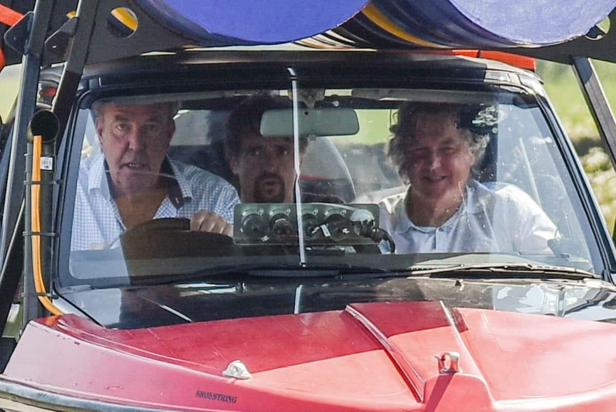 Jeremy Clarkson, accompanied by co-presenters Richard Hammond (in the back seat) and James May (in the front passenger seat), drives an odd vehicle in the outskirts of Huddersfield, West Yorks., May 25 2017. The car appears to be part boat, part car, and part jet engine, and filming has severly disrupted residents in the local village. See Ross Parry story RPYTOUR: