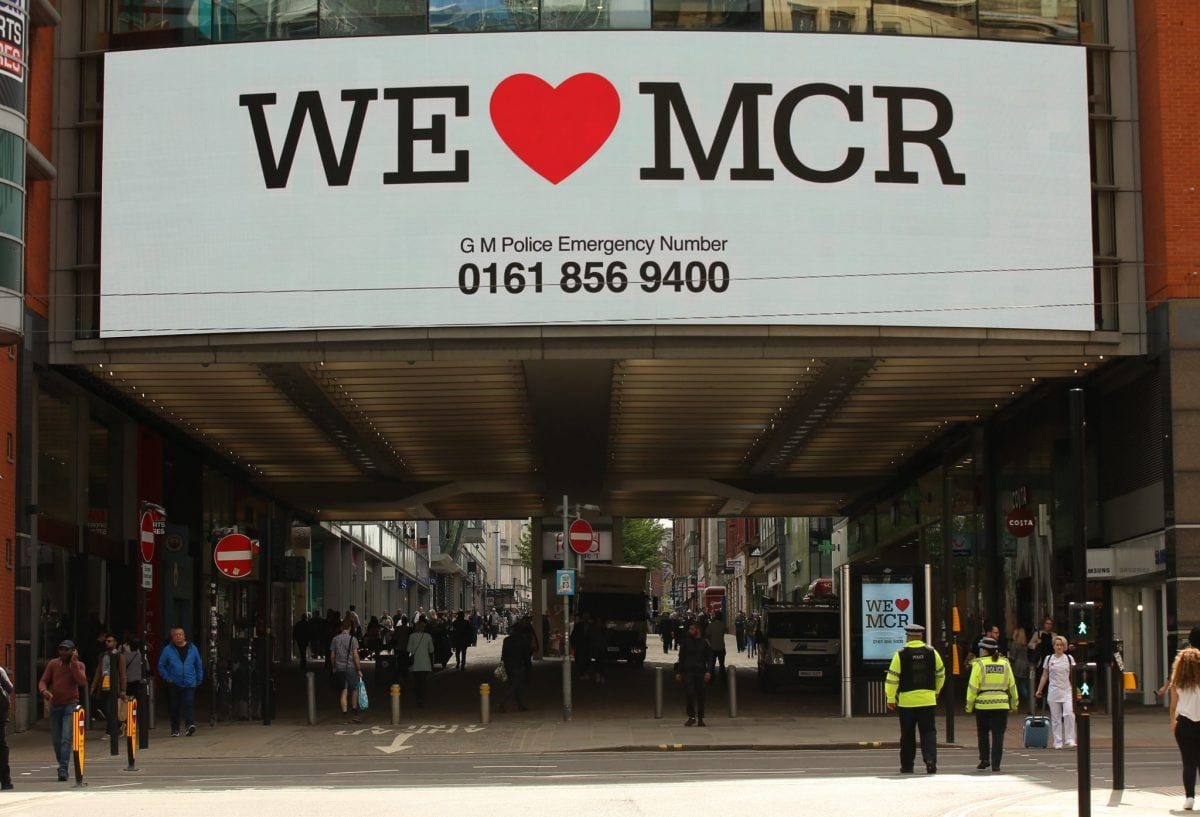 """We Love Manchester signs have begun to pop up around the city to show solidarity and to share a helpline for those effected by last nights terror attack in the city. At least 22 people have died, with more than 60 injured after an 'explosion' tore through a pop concert at Manchester Arena in a suspected terror attack. In a statement, GMP said: """"This is currently being treated as a terrorist incident until police know otherwise."""" Officers were called to reports of an explosion at the Manchester Arena just before 10.35pm on Monday, May 22. """"So far 19 people have been confirmed dead, with around 50 others injured,"""" the force said. Multiple witnesses reported hearing two """"huge bangs"""" at the venue shortly after US singer's gig finished at around 10.30pm on Monday evening. The area around the arena was swamped with police and emergency services and approach roads were cordoned off."""