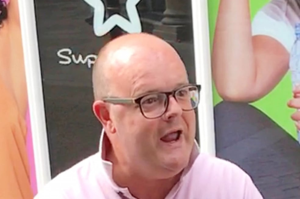 """Neil Hotchkiss in a picture taken during the rant in Worcester city centre.  A racist middle-aged yob has been fined for shouting abuse at a group of Muslims in the street - and asking them if they were """"planning a terrorist attack"""". See NTI story NTIRANT.  Neil Hotchkiss, 44, shocked passersby when he ranted at a businessman and his friends for seven minutes last Friday (7/7).  Street vendor, Selasie Clarke, 42, captured bald-headed Hotchkiss on camera and posted pictures of him on Facebook and contacted police.  Hotchkiss was arrested and on Monday (10/7) he appeared at Worcester Magistrates' Court where he admitted two counts of acting in a way likely to cause harassment, alarm or distress, which was religiously aggravated.  Hotchkiss, of Worcester, was handed a community order for 12 months and ordered to wear an electronic monitoring tag until October.  He was also ordered to pay two lots of £50 compensation, an £85 victim surcharge and £180 costs."""