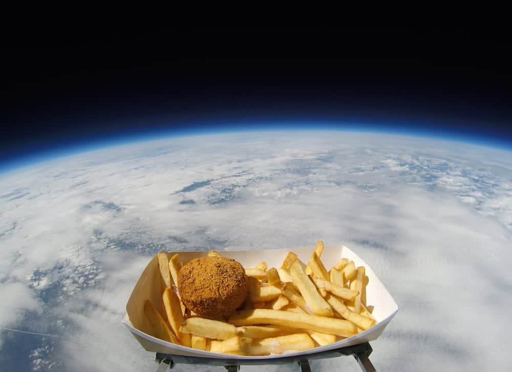 A RADIO station has joined the race for space - by blasting a beloved savoury dish into the stars. See Ross Parry story RPYPATTIE; The NASA-style space mission took off at 8.55am, as a Hull Pattie, along with a portion of chips sprinkled with chip spice, was shot almost 38,000 metres into the stratosphere tethered to a high-altitude weather balloon. The pattie was launched from a site in Sheffield, and reached a height of over 123,000ft  where temperatures fell to -50c and winds hit 150mph. An on-board camera filmed the tasty expedition, providing some stellar footage and data, as the meal touched down in a field just outside Wragby at 12.18pm.