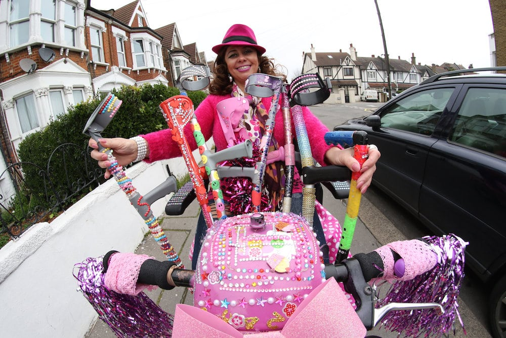 """Sarah Chelsom who is famous in South Norwood for her pink and highly decorated scooter. See National News story NNSCOOTER: A disabled woman says she was punched in the head for cruising around town on her bright pink mobility scooter - that is decorated with gemstones. Sarah Chelsom, who glammed-up her scooter with diamantes and rhinestones simply to make her neighbours' smile, says she was punched in back of the head as she rode around her home estate. Flamboyant Sarah, 51, from South Northwood, south London, is calling for more bobbies on the beat after she was left frightened after the unprovoked attack by an unknown female assailant. Sarah, said: """"Since then I felt so frightened and shaken up that I couldn't sleep and that's when I knew I needed to do something, South Norwood has gone downhill and even more so since the police station closed."""