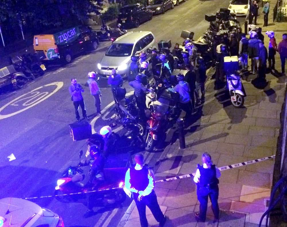 The scene at 22:25opm July 13 2017 on the Hackney Road junction with Queensbridge Road after reports of a serial acid attacker. See National News story NNACID; A man left with 'life changing' injuries following a spate of acid attack robberies was left screaming in agony as dozens of people rushed into the street to try and help him, witnesses said. He was targeted in a suspected robbery last night (Thurs) during a series of five attacks by men on a moped across north London in just 72 minutes, which police believe are linked. A major investigation has now been launched and a teenager has been arrested in connection with the attacks. The most serious has left a man with 'life-changing injuries', detectives said.