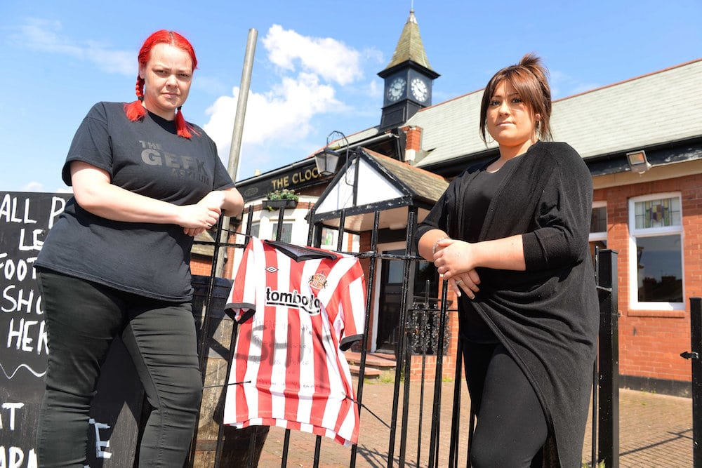 Bradley Lowery tribute defaced outside The Clock pub in Hebburn - (L-R) Kerry Neale and Taylor Joyce.  Heartless thugs have vandalised a shirt hung up in tribute to inspirational youngster Bradley Lowery - by writing a SWEAR word on it.  See ROSS PARRY story RPYBRADLEY.  A Sunderland AFC shirt with a heartfelt message to Bradley had been put up outside the Clock Pub, on Victoria Road East, Hebburn.  The loving message on the shirt read 'There is only one Bradley Lowery, rest in peace love. Alan and Yvonne xxx.'  But a disgusting swear word was daubed over the message sometime early this morning (July 13).  The despicable act was discovered when the pub opened this morning by the pub's manager, Andrea Howe, who has told of her disgust.