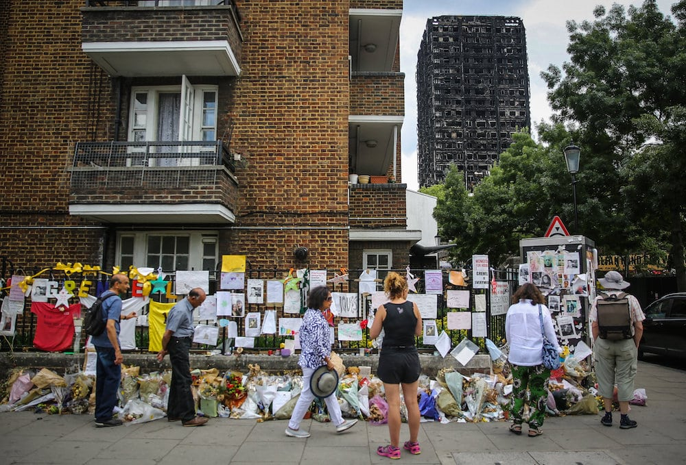 The charred remains of Grenfell Tower remains dominant in the landscape, a bleak memorial to 72 residents who burnt to death when the apartment caught fire on July 11 2017.