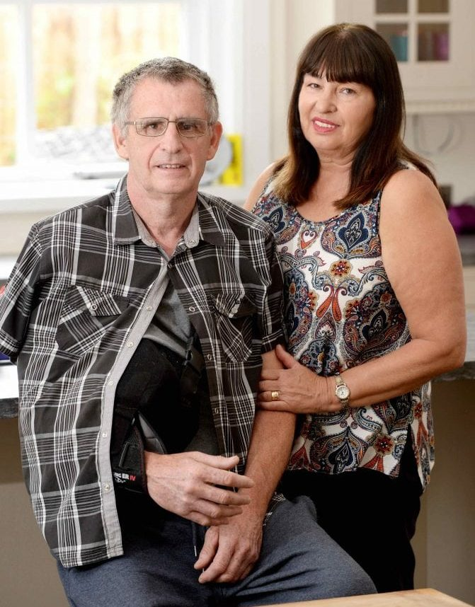 """Microlight pilot Eric Rhodes whon had a lucky escape after crashing near Skegness in May - Pictured with his wife Denise.  See NTI story NTIFALL.  A Leicestershire microlight pilot whose aircraft plunged to earth from 2,300 feet when a wing collapsed has spoken of his escape.  Eric Rhodes, 57, of Asfordby, near Melton, fell to earth within seconds of the catastrophic incident, suffering several fractured ribs and vertebrae, a punctured lung and wrenching his right shoulder from its socket.  Eric was flying from Skegness to Boston Aero Club, in Lincolnshire, where he is a member, at 65mph at about 4.15pm on Sunday, May 28 when the drama unfolded.   He said: """"I'd only been in the air 10 minutes. There was a terrific bang and the aircraft shook. Something hit me under the arm and ripped my shoulder out. I was lying down across the aircraft looking at the ground.  """"I could see the steering mechanism dangling from underneath the aircraft and I could see the ground coming towards me at a terrific speed.  """"I managed to pull myself up, looked up and saw the wing had folded and I was spiralling down.""""  In the handful of seconds Eric's aircraft plunged straight through a tiny gap in the canopy of a densely wooded copse in Wainfleet St Mary without hitting a single tree, missing deep lakes feet away on either side."""