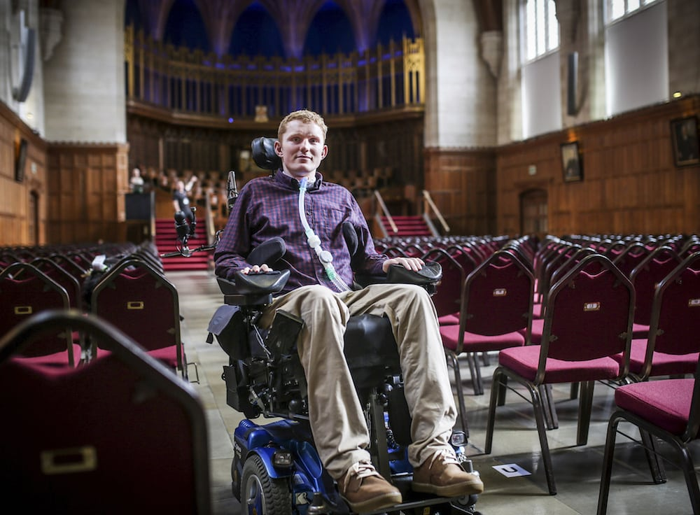 Rob Camm, who suffers from tetraplegia and is graduating from Bristol University with a first class degree. See SWNS story SWUNI: A student who is paralysed from neck down in a car crash has overcome the odds to graduate with first class honours from Bristol University. As new graduates grace the stage in Wills Memorial Building today, Rob Camm will join them in reaching yet another milestone in his life. The 23-year-old will graduate with a BSc in politics and philosophy, and will be welcomed with cheers from friends and family. It is fair to say life has not always gone his way. In September 2013, rugby player Rob was two weeks away from going to university when he was involved in a crash.