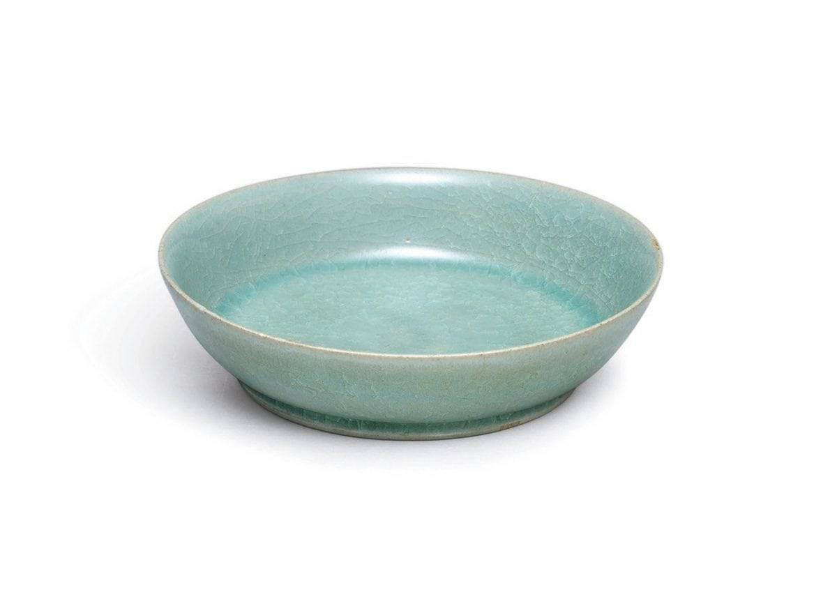 A small but highly-important ceramic dish from Imperial China is expected to sell for more than £10 MILLION at auction. See SWNS story SWBOWL; The brush washer is around 1,000 years old and was commissioned by the imperial court during the Song dynasty. And it was made by Ru guanyao, which is one of the most revered of the Five Great Kilns used during this period. The brush washer, which has a diameter of just 13cm, has a glowing, intense blue-green glaze and 'ice crackle' pattern. It is most likely the dish was made between 1086 and 1106 and it is extraordinarily rare for a Ru vessel to be sold at auction. There are thought to be just 87 pieces of Ru official ware in existence and only six have been sold publicly since 1940. The brush washer is one of only four in private hands and Sotheby's will auction it in Hong Kong on October 3.
