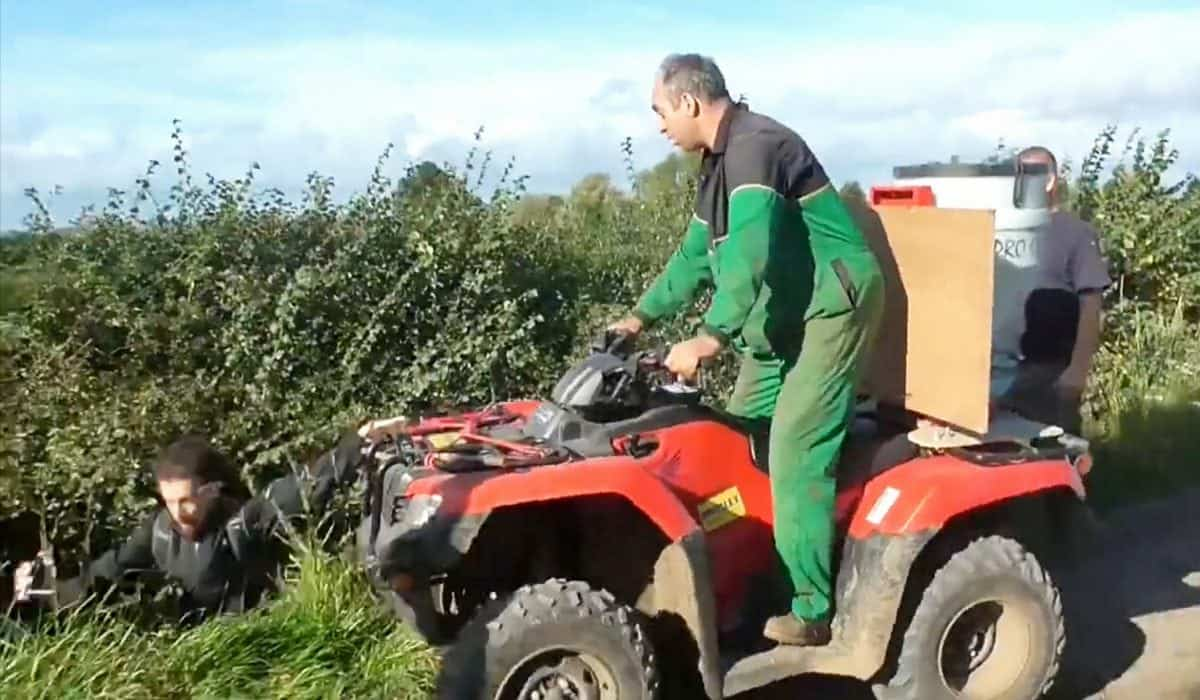 """This is the shocking moment a farmer was caught on camera driving a quad bike at a group of fox hunt demonstrators.  See NTI story NTIHUNT.  Footage released by West Midlands Hunt Saboteurs shows an altercation between a member of Atherstone Hunt and a group of protestors filming the hunt on their mobile phones.  The farmer, dressed in John Deere overalls, drives a quad bike up to three men and shouts at them to """"get off his land.""""  He then pushes one into a ditch and begins attacking whoever he can reach in the three-and-a-half minute video.  He confronts the demonstrators and tries to prevent them filming him before knocking another to the ground.  He continues to drive at the protestors with his quad bike, telling them, """"You are on private property, I can do what I want.""""  The dramatic footage filmed on Saturday (14/10) in Ratcliffe Culey, Leics., captures the moment the farmer drives another person into a ditch and can be heard saying, """"That's one more, does anybody else want some?"""""""