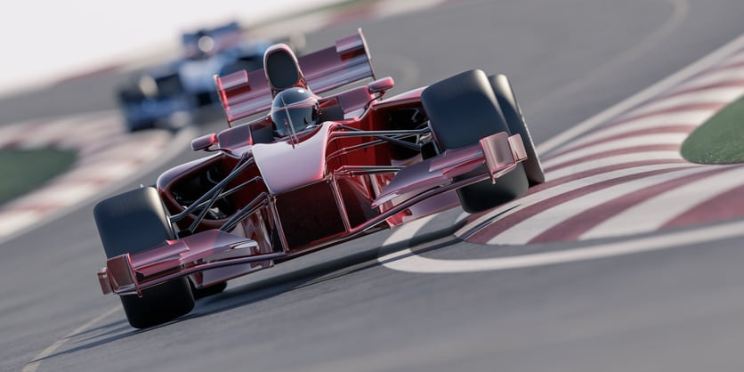 Formula one type racing cars speeding around a bend in the track. All elements are designed and modelled by myself. Very high resolution 3D render.