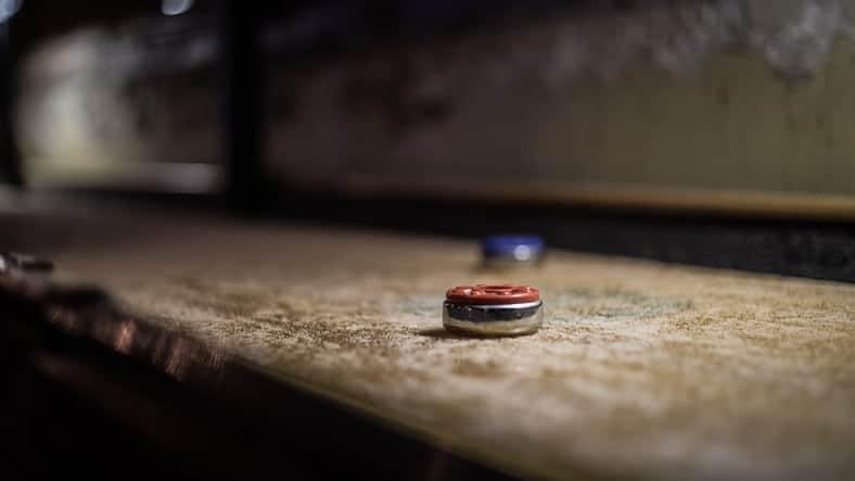 A disc of a deck shuffleboard.