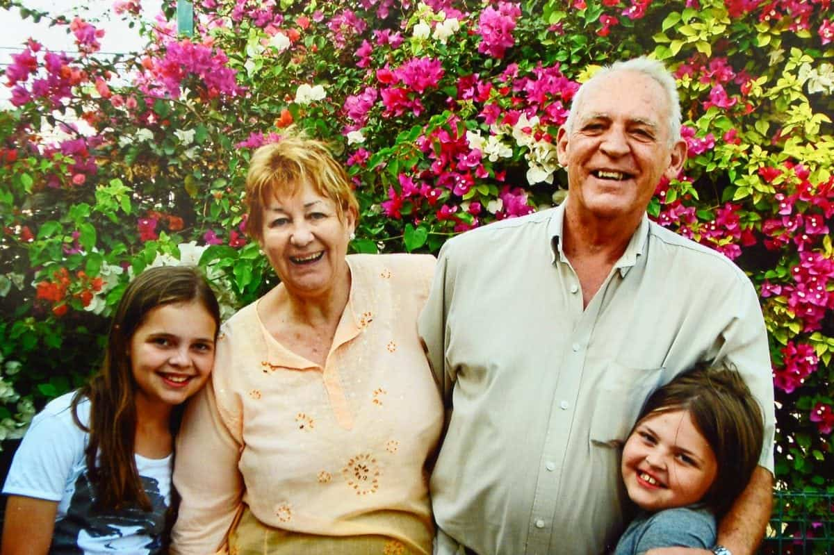 """Collect of Brenda with her late husband Brian and their Grandchildren in the Seychelles. See NTI story NTIROYAL. A grandmother who is 18th cousin of the Queen is facing being deported back to South Africa after she was refused a visa to live in the UK. Brenda Ackerman, 71, traced her family tree back to the 12th Century which revealed her to be a distant relative of King John James 1st and Robert the Bruce. Mrs Ackerman was born in South Africa but fled in 2006 with her husband Brian after a string of burglaries. They moved to Dubai to be with their daughter Candice Gordon, 45, before finally settling in the UK in 2013 following the death of Mrs Ackerman's husband Brian. Last February, Mrs Ackerman applied for a long-term visa but it was turned down, despite her suffering from a pulmonary embolism and being in failing health. Mrs Ackerman's daughter has been granted permission to remain in the UK but the widow has now been informed she will be deported unless she returns to South Africa voluntarily. Mrs Ackerman, who currently lives with her daughter in Worcester, said: """"My descendants were British."""