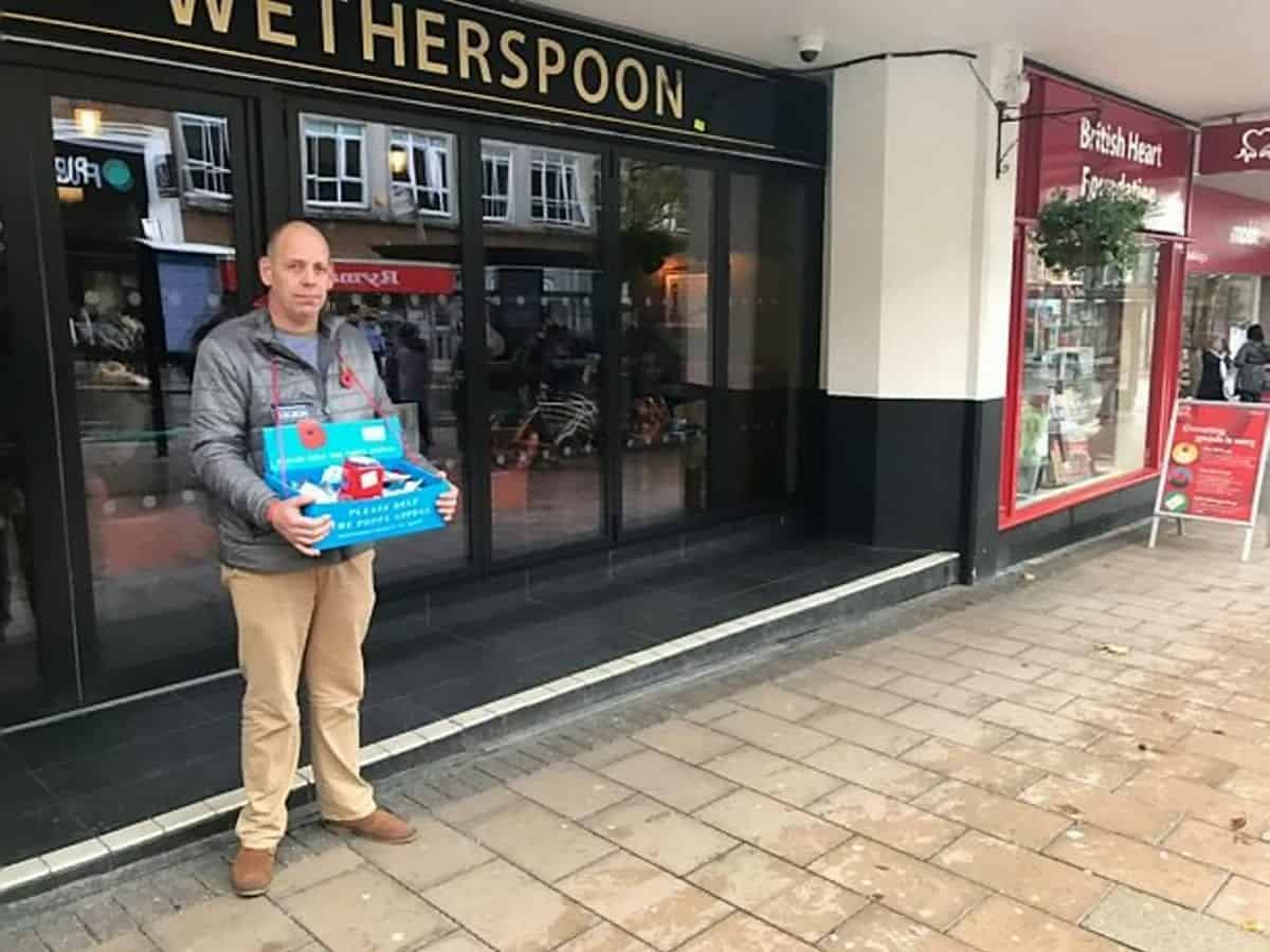 Poppy seller .Pete West, 47, who was forced to stand in the rain - after a Wetherspoons pub manager told him he couldn't use the pub's concrete canopy.See SWNS story SWPLpoppy.Pub chain Wetherspoons has apologised after staff forced a poppy seller who was seeking shelter outside one of their pubs - to stand out in the rain.Pete West, 47, was selling the Royal British Legion's decorative poppies to passers-by as the heavens opened.To stay dry, Pete stood under a concrete canopy which forms part of The Chevalier pub in Exeter, Devon.But the manager of the pub came out and told Pete he wouldn't be able to stand there as they didn't have a license. (SWNS)