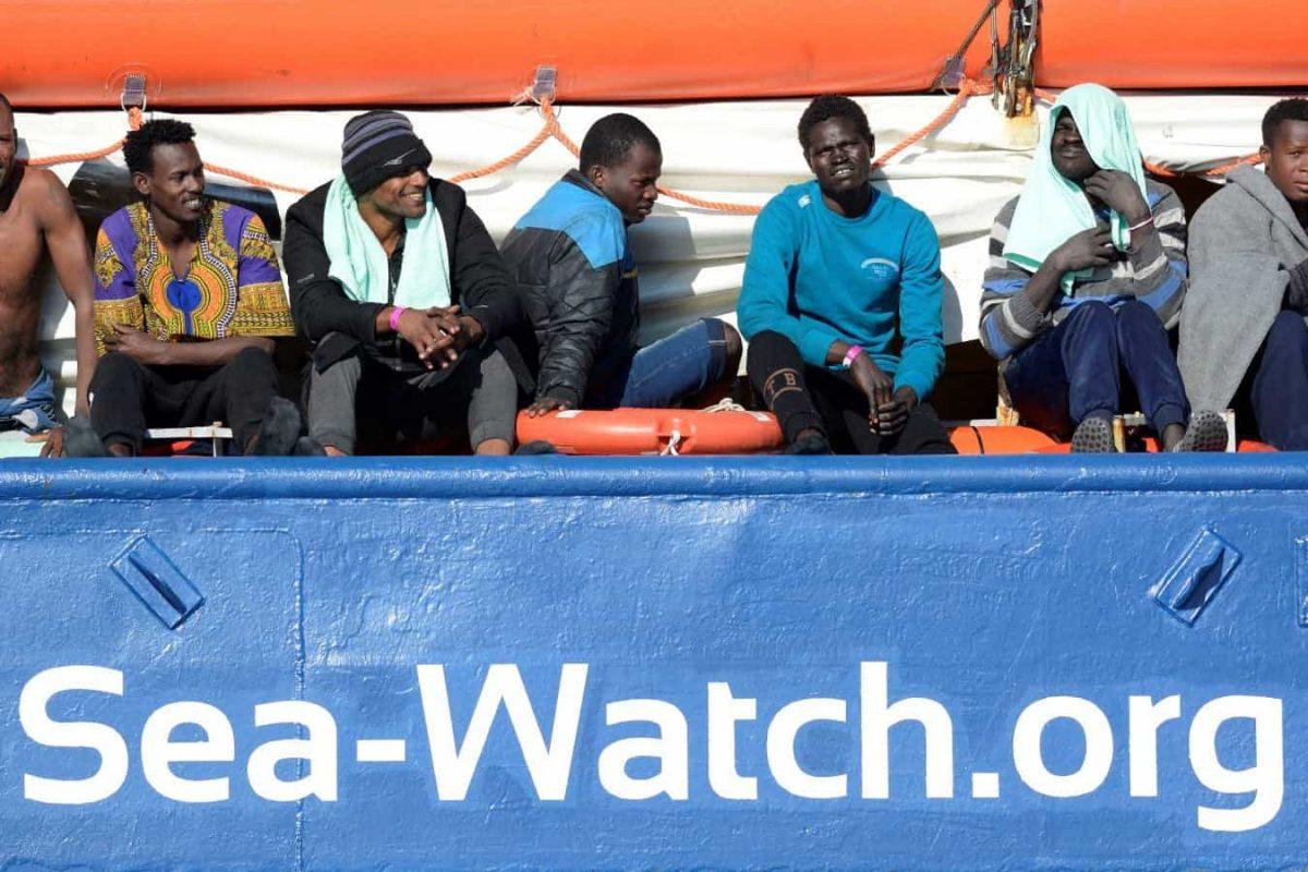 FILE PHOTO: Migrants rest on board the Sea Watch 3 off the coast of Siracusa, Italy, January 27, 2019. REUTERS/Guglielmo Mangiapane/File Photo