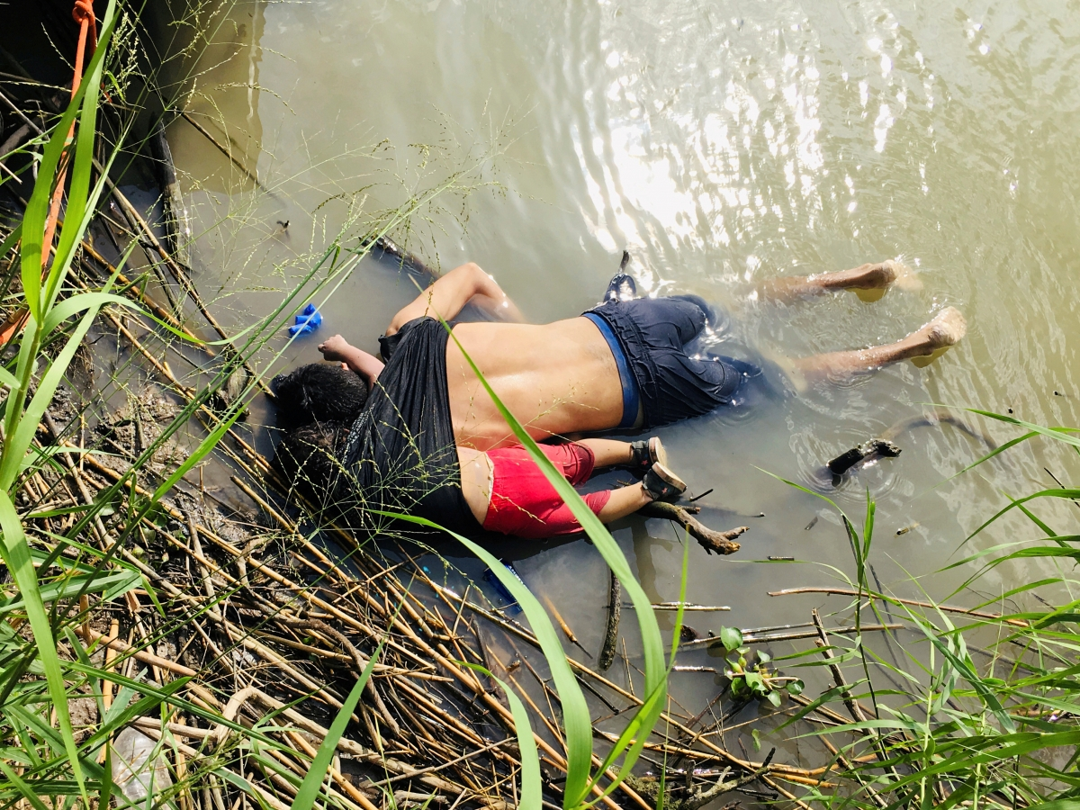 The bodies of Salvadorian migrant Oscar Alberto Martinez Ramirez and his daughter Valeria are seen after they drowned in the Rio Bravo river while trying to reach the United States, in Matamoros, in Tamaulipas state, Mexico June 24, 2019. REUTERS/Stringer