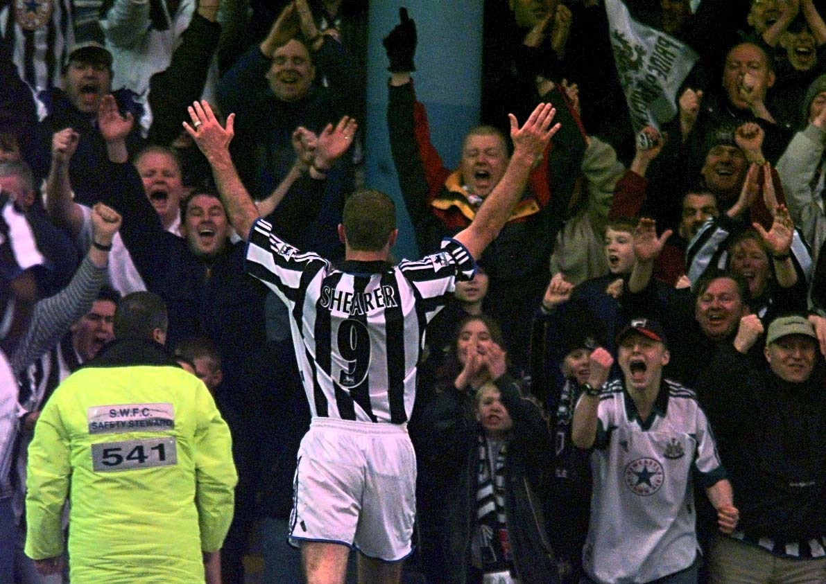 This picture can only be used within the context of an editorial feature. Newcastle United captain Alan Shearer celebrates with the fans after scoring Newcastle's second goal against Sheffield Wednesday during their FA Premiership match at Hillsborough.   * Final Score: Sheffield Wednesday 0  Newcastle United 2.