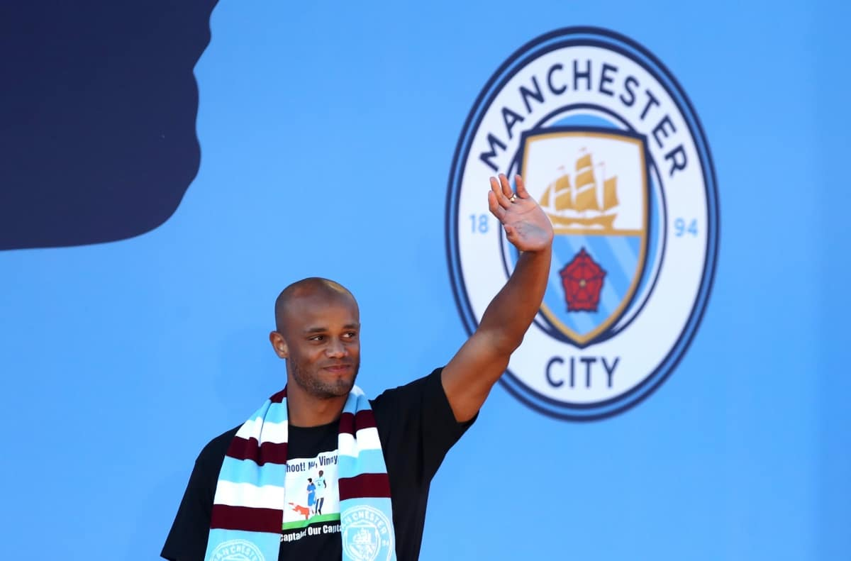 Manchester City's Vincent Kompany waves to fans during the trophy parade in Manchester.