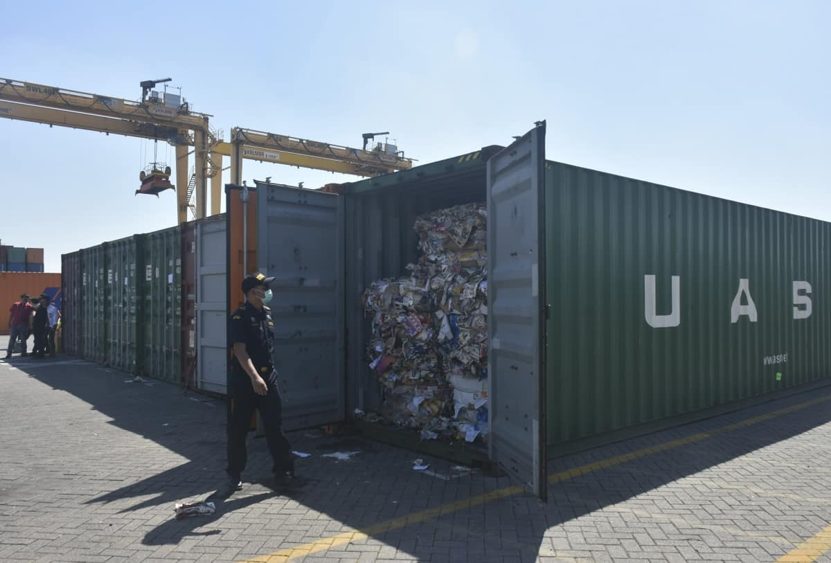 Indonesian custom officers open containers full of waste at the Tanjung Perak port in Surabaya, East Java, Indonesia, Tuesday, July 9, 2019. Indonesia is sending dozens of containers of imported waste back to Western nations after finding it was contaminated with used diapers, plastic and other materials, adding to a growing backlash in Southeast Asia against being a dumping ground for the developed world's rubbish.(AP Photo)