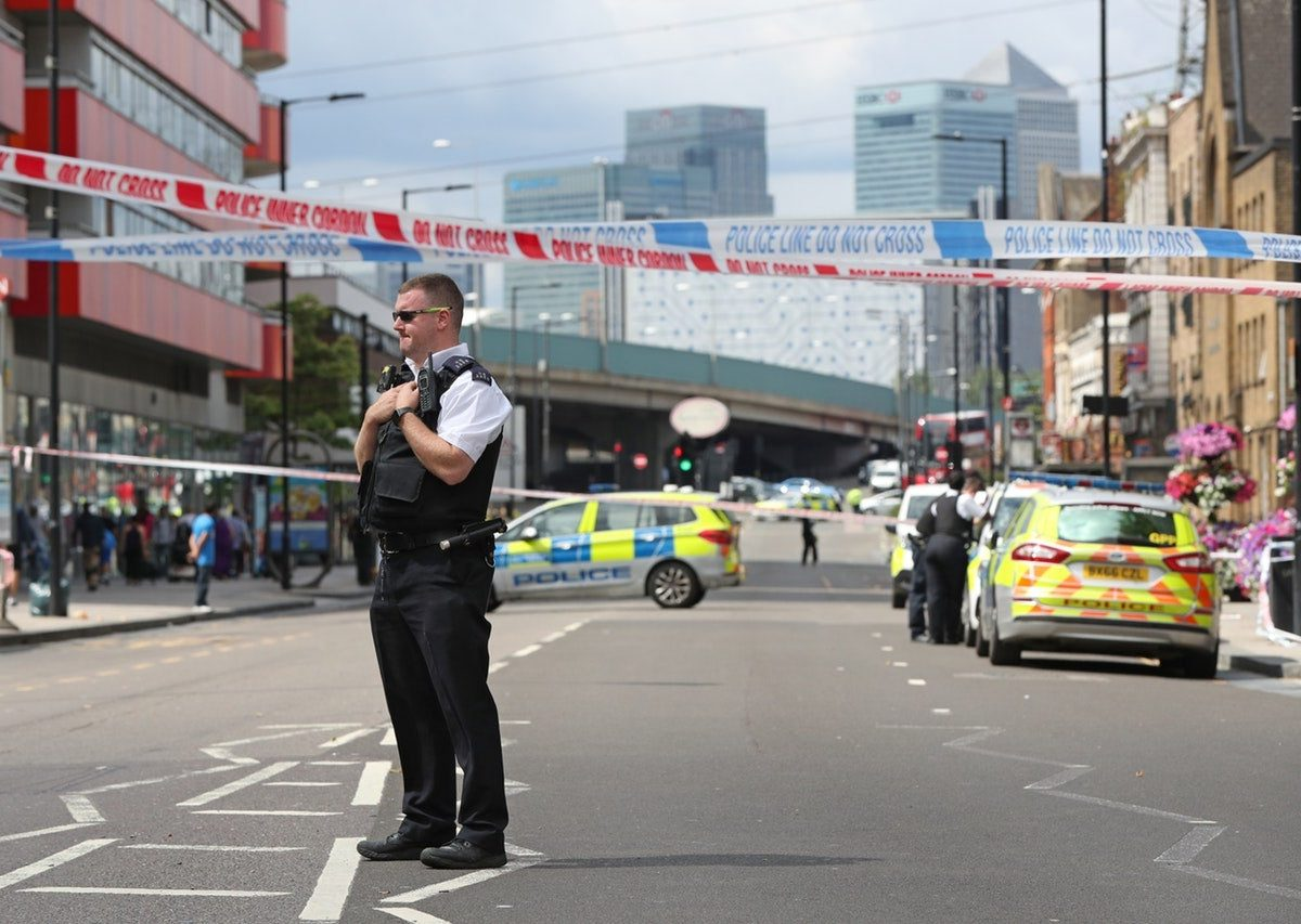 A police officer at the scene of a stabbing in Canning Town, east London (Jonathan Brady/PA)