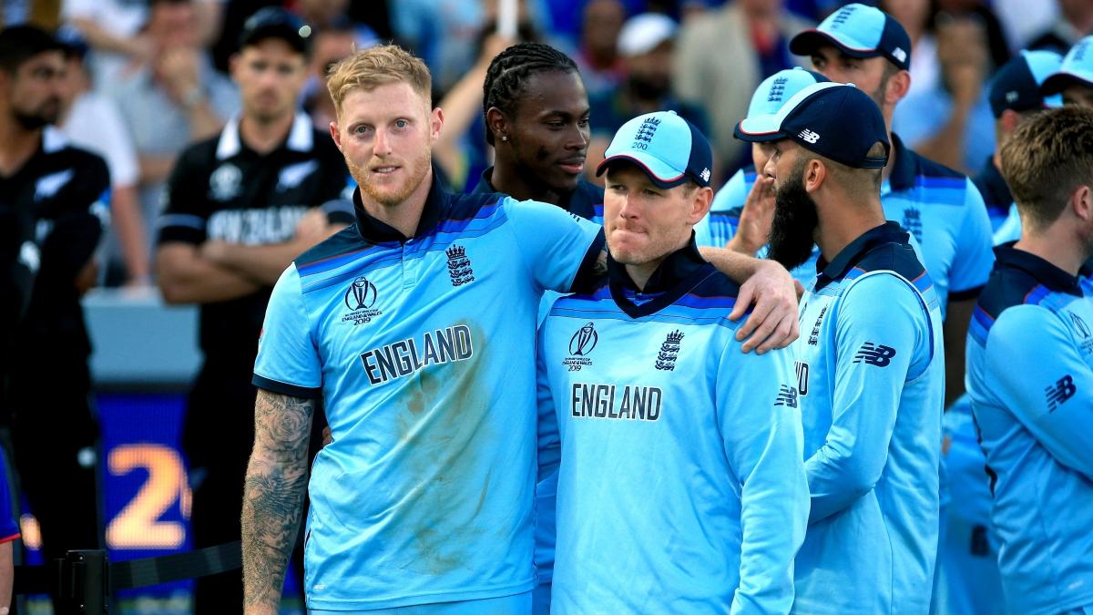 England's Ben Stokes, left, and Eoin Morgan celebrate their win (Nick Potts/PA)