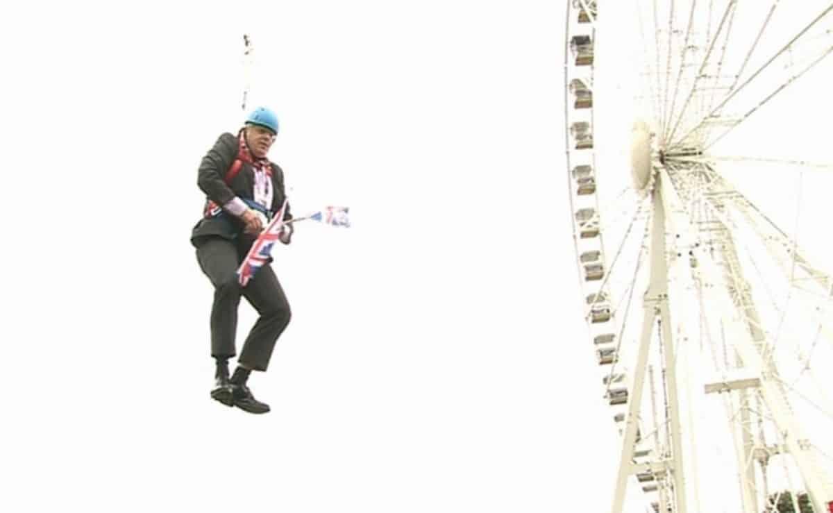 Boris Johnson gets stiuck on a zipwire (PA)