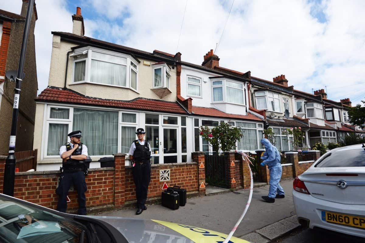 Police officers at the scene in Raymead Avenue, Thornton Heath, where Kelly Mary Fauvrelle was stabbed to death (Kirsty O'Connor/PA)