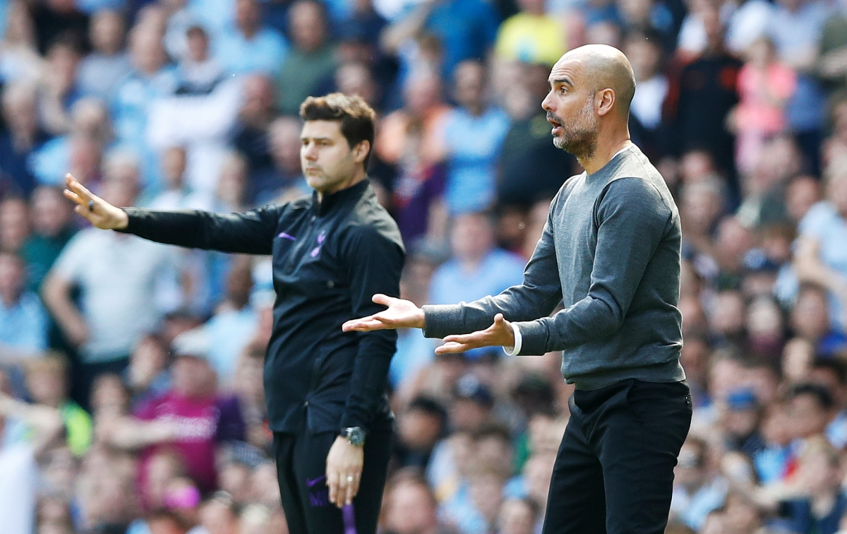 Tottenham Hotspur manager Mauricio Pochettino (left) and Manchester City manager Pep Guardiola on the touchline during the Premier League match at the Etihad Stadium, Manchester.